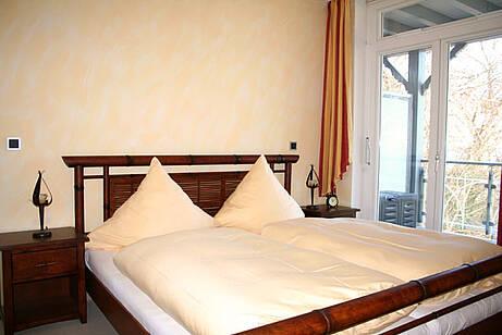 Schlafzimmer der Ferienwohnung 14 in der Villa Wagenknecht
