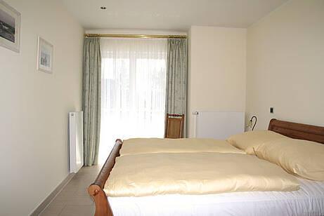 Schlafzimmer der Ferienwohnung 05 in der Villa Wageknecht