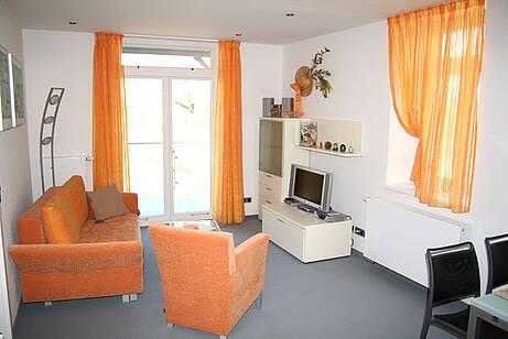 Wohnzimmer der Ferienwohnung 07 in der Villa Wagenknecht